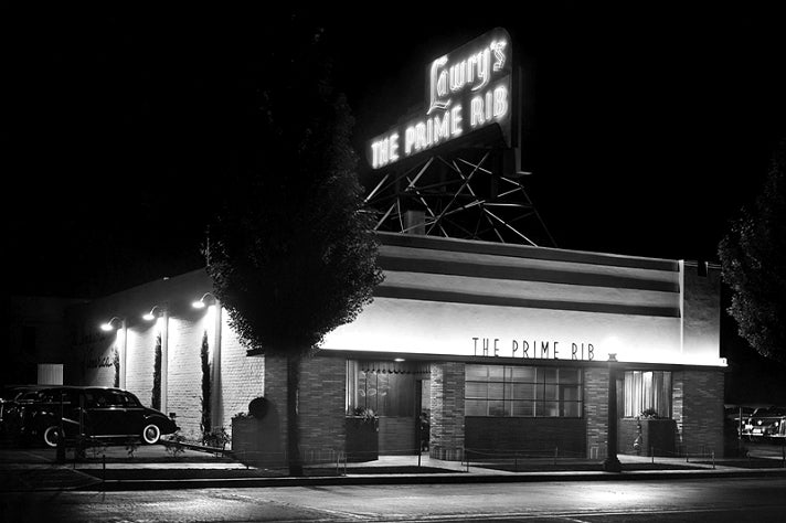 Nighttime photo of Lawry's The Prime Rib at its original location in 1938