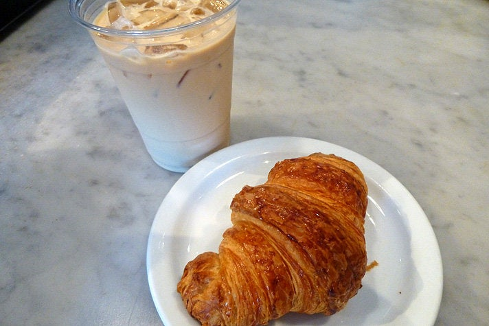 Croissant and iced latte at Proof Bakery